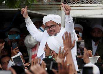 Indonesia jails Muslim leader for concealing COVID test result